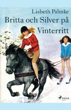 Britta och Silver på vinterritt :