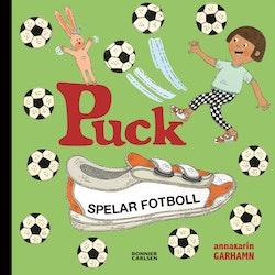 Puck spelar fotboll