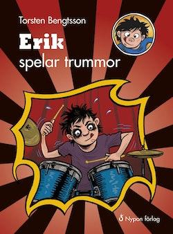 Erik spelar trummor